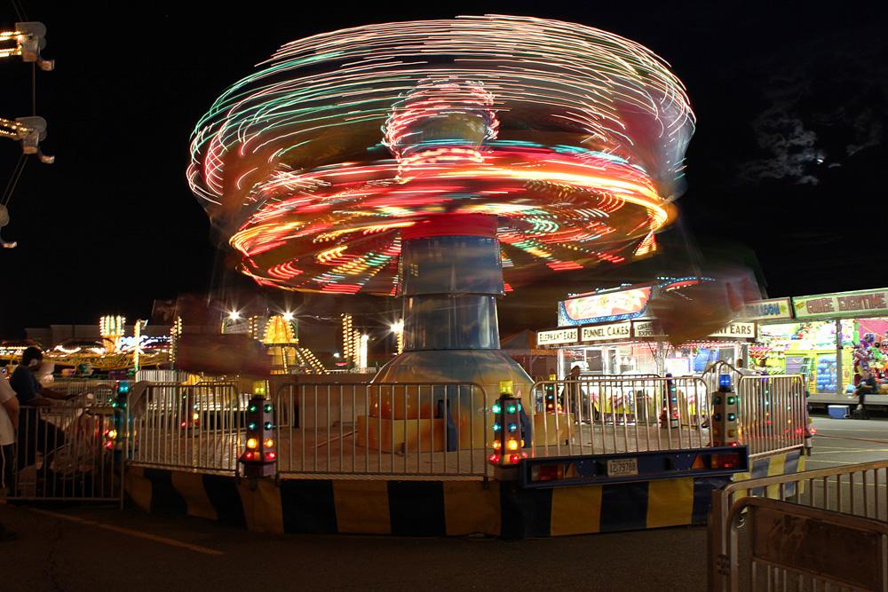 Newtonian Carnival: Swirl Whirl - Jordan Ladikos